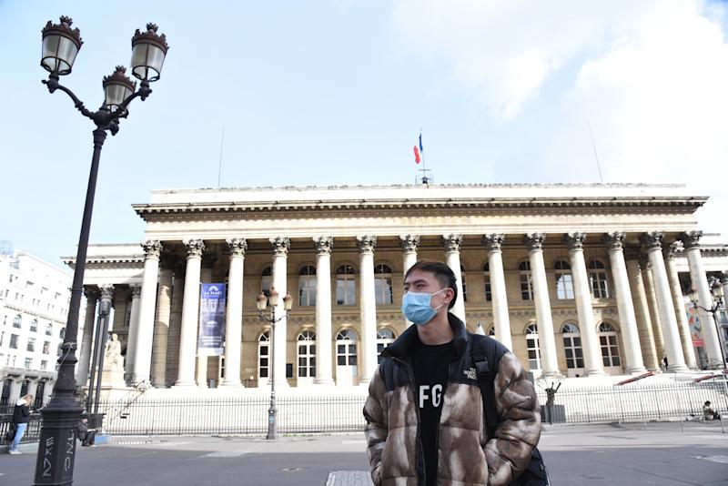 People wearing masks against Coronavirus Covid-19 at Paris Stock Exchange in France.