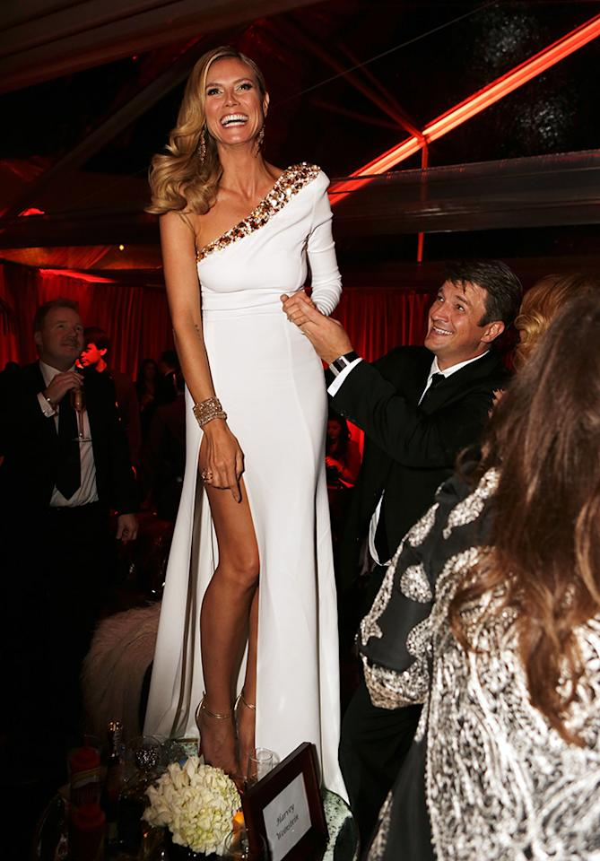 Heidi Klum and Nathan Fillion attend the The Weinstein Company's 2013 Golden Globe Awards after party presented by Chopard, HP, Laura Mercier, Lexus, Marie Claire, and Yucaipa Films held at The Old Trader Vic's at The Beverly Hilton Hotel on January 13, 2013 in Beverly Hills, California.