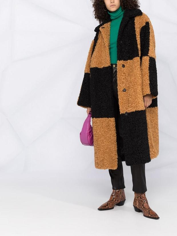 """<p>Stand Studio Faux Shearling Checkered Coat, $509, <a href=""""https://rstyle.me/+MJAbaUG2NY-BIkgRRQlH0Q"""" rel=""""nofollow noopener"""" target=""""_blank"""" data-ylk=""""slk:available here"""" class=""""link rapid-noclick-resp"""">available here</a>. </p>"""