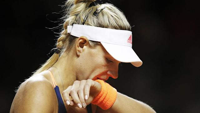 Angelique Kerber lost at the Stuttgart Open for the first time since 2014 as Kristina Mladenovic stunned the world number two.