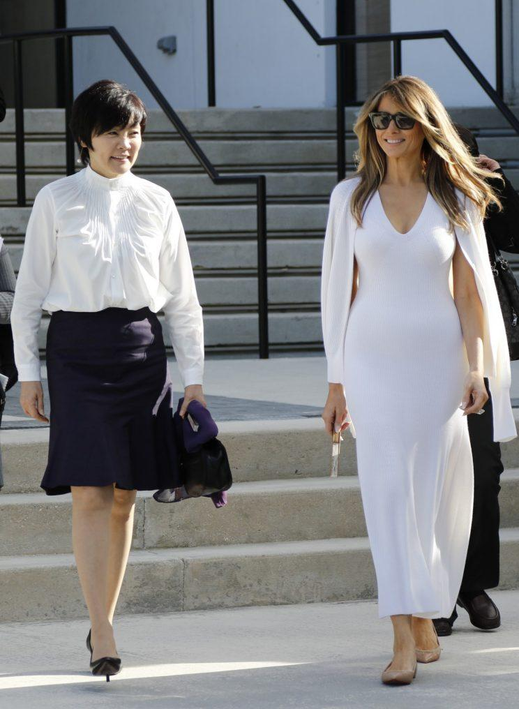 Akie Abe, wife of Japanese Prime Minister Shinzo Abe, left, and first lady Melania Trump walk together as they tour Morikami Museum and Japanese Gardens in Delray Beach, Fla., on Saturday, Feb. 11, 2017. Photo: AP /Terry Renna