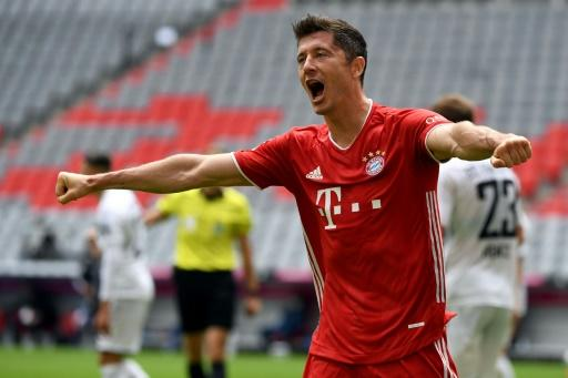 Robert Lewandowski celebrates setting a new record for the most league goals scored by a foreigner in Saturday's 3-1 home German league win over Freiburg