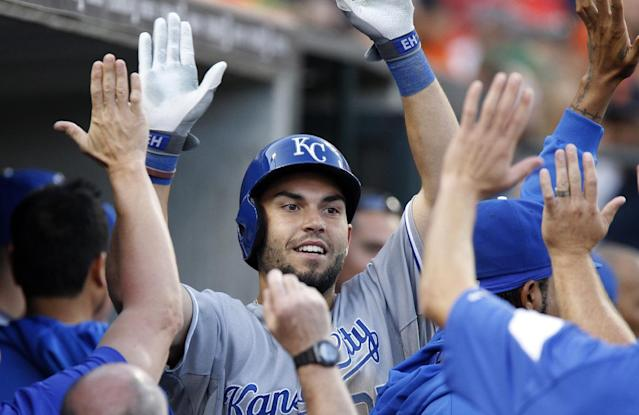 Kansas City Royals' Eric Hosmer (35) celebrates his two-run home run in the dugout in the third inning during the second game of a doubleheader baseball game against the Detroit Tigers, Friday, Aug. 16, 2013, in Detroit. (AP Photo/Duane Burleson)