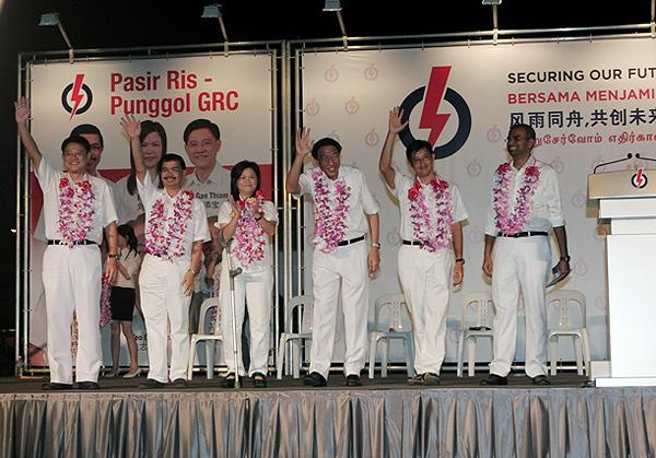 Candidates (L-R) Gan Thiam Poh, Zainal Sapari, Penny Low, Teo Chee Hean, Teo Ser Luck and Janil Puthucheary are seen at PAP's first rally this election. (Yahoo Photo/Marianne)