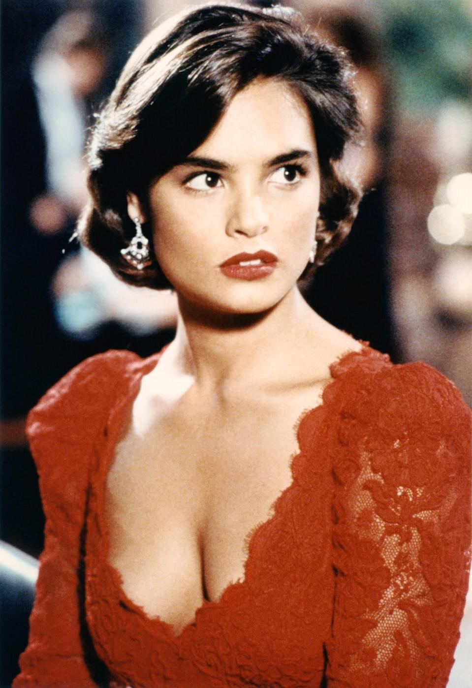 <p>As the beautiful girlfriend of Franz Sanchez, a powerful Latin American drug lord, she turns against him and helps Bond. Her dark eyes, bold brows, and red lips made Lamora quite the stunner. <i>(Photo: Everett Collection)</i></p>