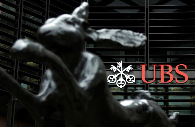 FILE PHOTO: The offices of Swiss bank UBS are seen in the financial district of the City of London