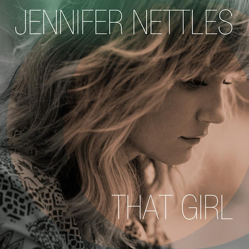 "This CD cover image released by Universal Nashville shows ""That Girl,"" by Jennifer Nettles. Nettles made her career singing with others as a part of the Grammy-winning band Sugarland and performing well-known duets with artists like Bon Jovi, James Taylor and many more. But now she's striking out on her own with her first solo album.Universal Nashville (AP Photo/Universal Nashville)"
