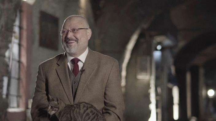 "In this image made from a March 2018 video provided by Metafora Production, Jamal Khashoggi reacts as a cat jumped on his lap, while speaking in an interview at an undisclosed location. Eighteen days after Khashoggi disappeared, Saudi Arabia acknowledged early Saturday, Oct. 20, 2018, that the 59-year-old writer has died in what it said was a ""fistfight"" inside the Saudi consulate in Istanbul."