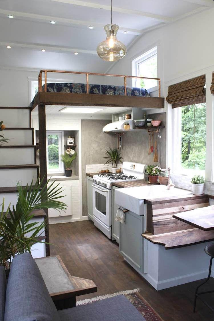 """<p>As soon as you walk inside this tiny 250-square-foot home, a tidy and warm escape full of country character greets you. Natural light swims throughout the space, and farmhouse-inspired wood accents (most of which are made from salvaged and reclaimed wood) give it a rustic yet modern touch. </p><p><a class=""""link rapid-noclick-resp"""" href=""""https://www.countryliving.com/real-estate/a38780/handcrafted-tiny-house/"""" rel=""""nofollow noopener"""" target=""""_blank"""" data-ylk=""""slk:SEE INSIDE"""">SEE INSIDE</a></p>"""