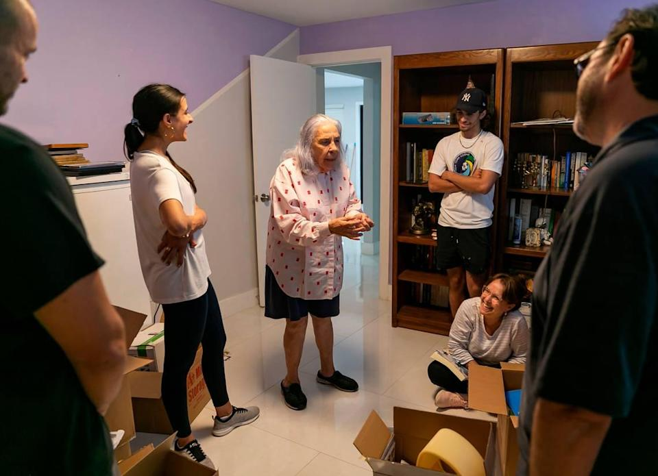 Ana Lazara Rodriguez, center, tells a story as friends help her move into her new home in Miami's Coral Terrace neighborhood on Monday, Sept. 27, 2021. Rodriguez, who was previously facing eviction, was able to move into this house after an anonymous benefactor bought her the four-bedroom, two-bath home for $690,000.