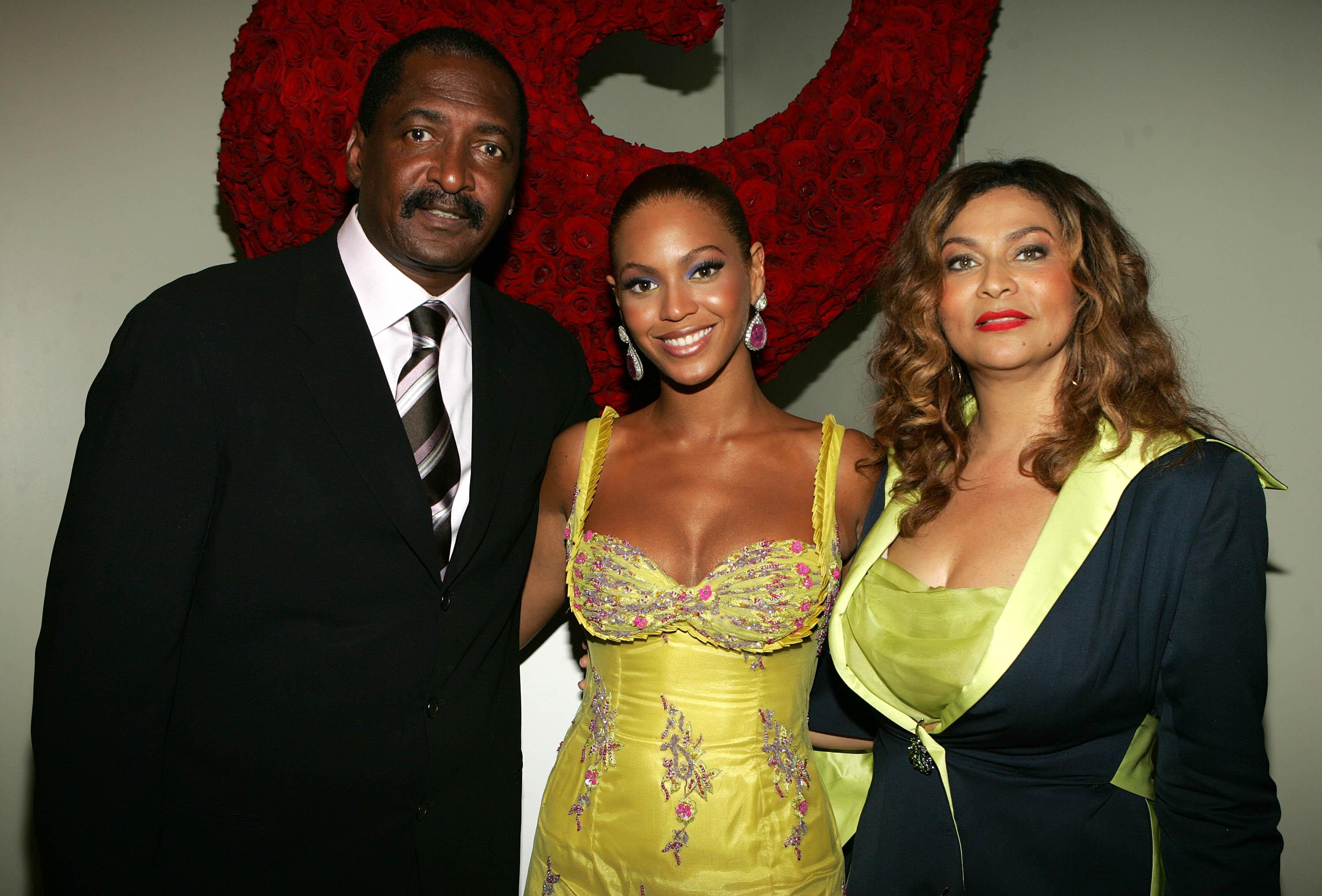 Beyonce photographed with her parents, Mathew and Tina Knowles, at an event in 2005 [Photo: Getty]
