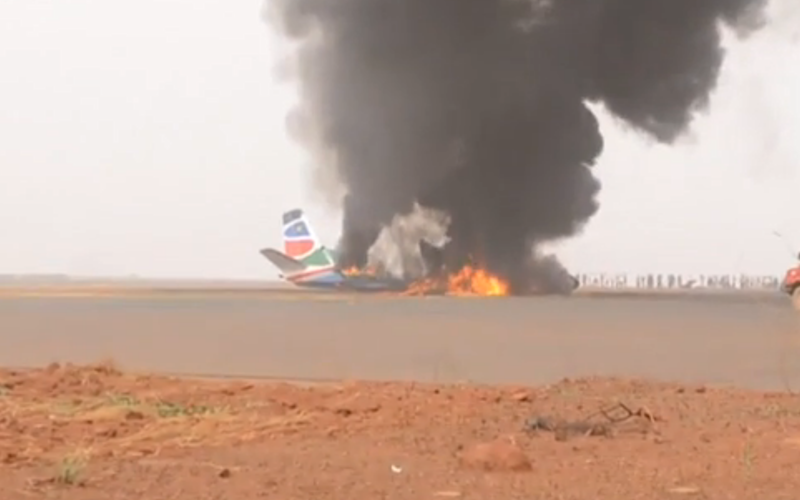 Plane wreckage on fire - Credit: ITN