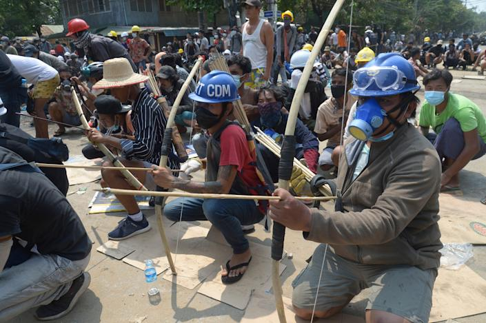 March 27, 2021: Anti-coup protesters prepare makeshift bow and arrows to confront police in Thaketa township Yangon, Myanmar. The head of MyanmarÕs junta on Saturday used the occasion of the countryÕs Armed Forces Day to try to justify the overthrow of the elected government of Aung San Suu Kyi, as protesters marked the holiday by calling for even bigger demonstrations.