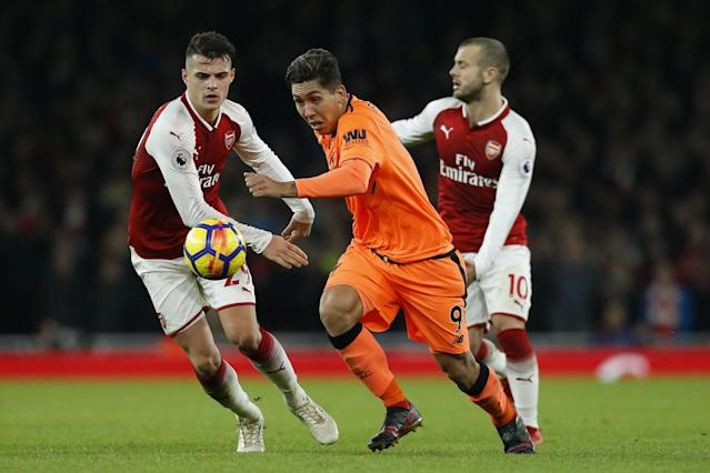 Roberto Firmino duels with Granit Xhaka and Jack Wilshere during Friday's 3-3 draw between Liverpool and Arsenal. (Getty)