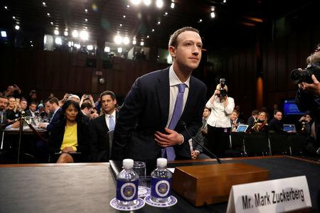 FILE PHOTO: Facebook CEO Mark Zuckerberg arrives to testify before a Senate Judiciary and Commerce Committees joint hearing regarding the company's use and protection of user data, on Capitol Hill in Washington, DC, U.S., April 10, 2018.  REUTERS/Aaron P. Bernstein/File Photo