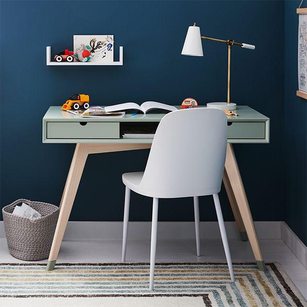 """<h2>Marmalade Jensen Desk</h2><br>A savvy small-space furniture hack? Shop the kids' section. This compact two-drawer desk in a muted seafoam hue is just as stylish (if not more) than its made-for-adult counterparts — just make sure the height measurements will fit your grown-up proportions!<br><br><strong>Marmalade</strong> Jensen Desk, $, available at <a href=""""https://go.skimresources.com/?id=30283X879131&url=https%3A%2F%2Fwww.bedbathandbeyond.com%2Fstore%2Fproduct%2Fmarmalade-trade-jensen-desk%2F5332156"""" rel=""""nofollow noopener"""" target=""""_blank"""" data-ylk=""""slk:Bed Bath and Beyond"""" class=""""link rapid-noclick-resp"""">Bed Bath and Beyond</a>"""