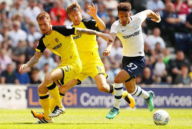 "Soccer Football - Championship - Preston North End vs Burton Albion - Deepdale, Preston, Britain - May 6, 2018 Burton Albion's Kyle McFadzean and Kyle McFadzean in action with Preston North End's Callum Robinson Action Images/Jason Cairnduff EDITORIAL USE ONLY. No use with unauthorized audio, video, data, fixture lists, club/league logos or ""live"" services. Online in-match use limited to 75 images, no video emulation. No use in betting, games or single club/league/player publications. Please contact your account representative for further details."