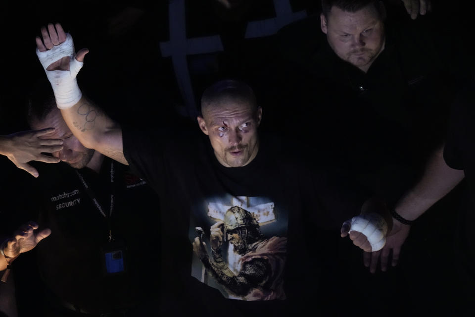 Oleksandr Usyk of Ukraine waves to spectators after his unanimous decision victory over Anthony Joshua of Britain in their WBA (Super), WBO and IBF boxing title bout at the Tottenham Hotspur Stadium in London, Saturday, Sept. 25, 2021. (AP Photo/Frank Augstein)