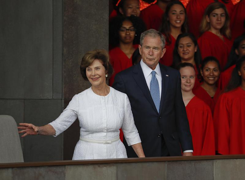 In this photo taken Sept. 24, 2016, former President George W. Bush and former first lady Laura Bush are seen in Washington. Falling in line with tradition, Bill and Hillary Clinton plan to attend Donald Trump's inauguration. It's a decision that will put Hillary Clinton on the inaugural platform as her bitter rival from the 2016 campaign assumes the office she long sought. The Clintons announced their decision to attend the Jan. 20 inauguration shortly after former President George W. Bush's office said Tuesday he would attend along with former first lady Laura Bush. (AP Photo/Pablo Martinez Monsivais, File)