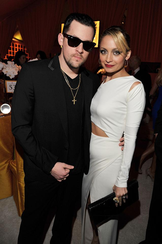 Joel Madden kept it casual in an all-black ensemble, while Nicole Richie glammed it up -- in a chic Halston frock and smokey eyes -- at Elton John's annual party.