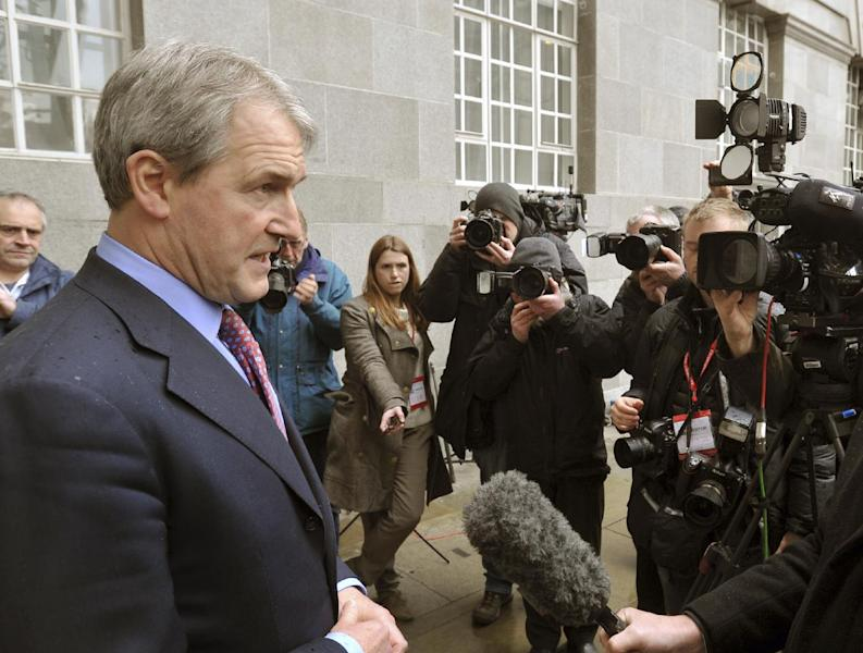 Secretary of State for Environment, Food and Rural Affairs (Defra) Owen Paterson, left, speaks to the media outside Defra Headquarters in London, Saturday Feb. 9, 2013, after an emergency meeting with the Food Standards Agency (FSA) and representatives of various leading retailers, as revelations about the widespread use of horseheat in supermarket beef products continues to hit consumer confidence. Concerns about the use of horsemeat burst into the spotlight earlier this year, after it emerged that some beef products contained horse DNA, and now the whole industry faces pressure to test their products and reveal the findings. (AP Photo / John Stillwell, PA) UNITED KINGDOM OUT - NO SALES - NO ARCHIVES