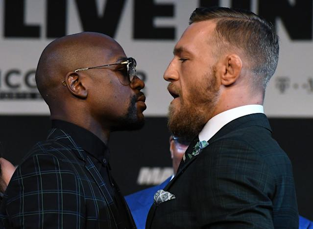 Floyd Mayweather Jr. and Conor McGregor prepare for their flashy fight. (Photo: Getty Images)
