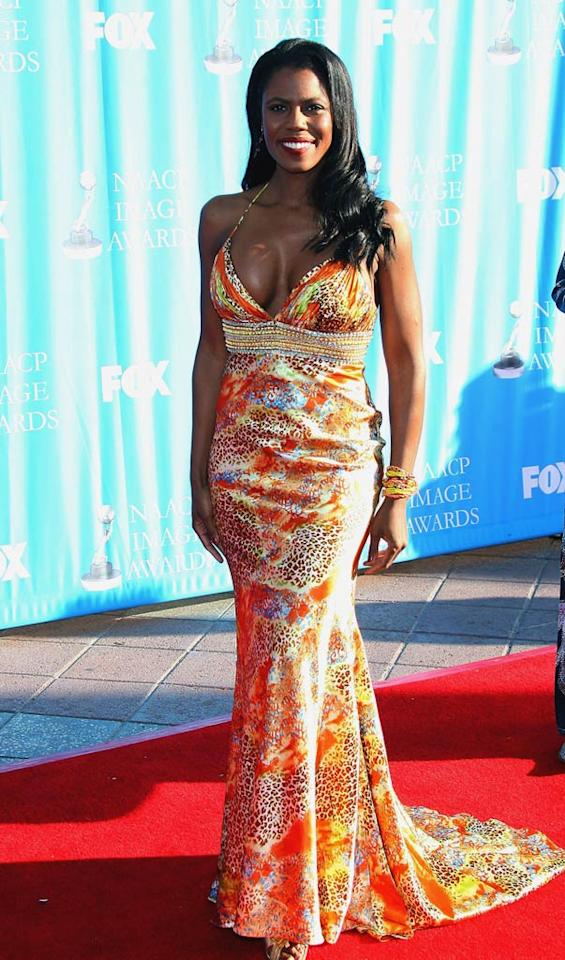 "Reviled reality villainess Omarosa Manigault-Stallworth shows of her surgically enhanced chest in an unflattering low-cut dress. Maury Phillips/<a href=""http://www.wireimage.com"" target=""new"">WireImage.com</a> - February 1, 2008"