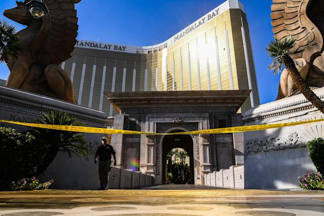<p>An agent walks out of Mandalay Bay Hotel and Casino where Stephen Paddock, the gunman who killed dozens and injured hundreds during the Route 91 Harvest Country Music Festival is seen on Wednesday, Oct.4, 2017, in Las Vegas, Nev. (Photo: Salwan Georges/The Washington Post via Getty Images) </p>
