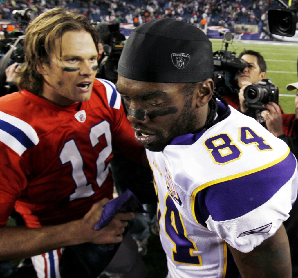New England Patriots quarterback Tom Brady shakes hands with Minnesota Vikings wide receiver Randy Moss after New England's 28-18 win in an NFL football game in Foxborough, Mass., Sunday, Oct. 31, 2010.