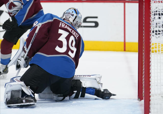 Colorado Avalanche goaltender Pavel Francouz (39) is scored on by Columbus Blue Jackets defenseman Zach Werenski during the first period of an NHL hockey game, Saturday, Nov. 9, 2019, in Denver. (AP Photo/Jack Dempsey)