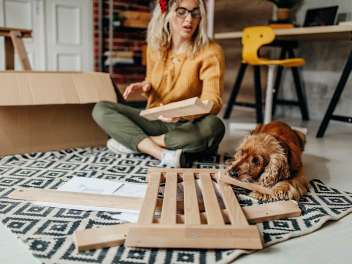 A woman works on building a new chair.