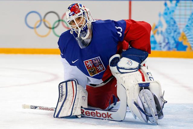 Czech Republic goaltender Ondrej Pavelec looks up during the second period after the fourth U.S. goal at the men's quarterfinal hockey game in Shayba Arena at the 2014 Winter Olympics, Wednesday, Feb. 19, 2014, in Sochi, Russia. (AP Photo/Petr David Josek)