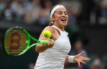 FILE PHOTO - Tennis - Wimbledon - London, Britain - July 11, 2017 Latvia's Jelena Ostapenko in action during her quarter final match against Venus Williams of the U.S. REUTERS/Tony O'Brien