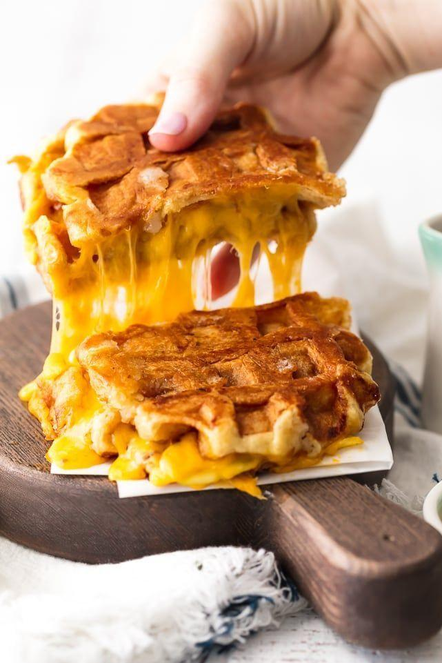 """<p>Just <em>look</em> at that cheese pull! Serve this sandwich for brunch, dinner, or just as an afternoon snack.</p><p><strong>Get the recipe at <a href=""""https://www.thecookierookie.com/apple-cheddar-waffle-sandwich-waffle-grilled-cheese/"""" rel=""""nofollow noopener"""" target=""""_blank"""" data-ylk=""""slk:The Cookie Rookie"""" class=""""link rapid-noclick-resp"""">The Cookie Rookie</a>.</strong> </p>"""