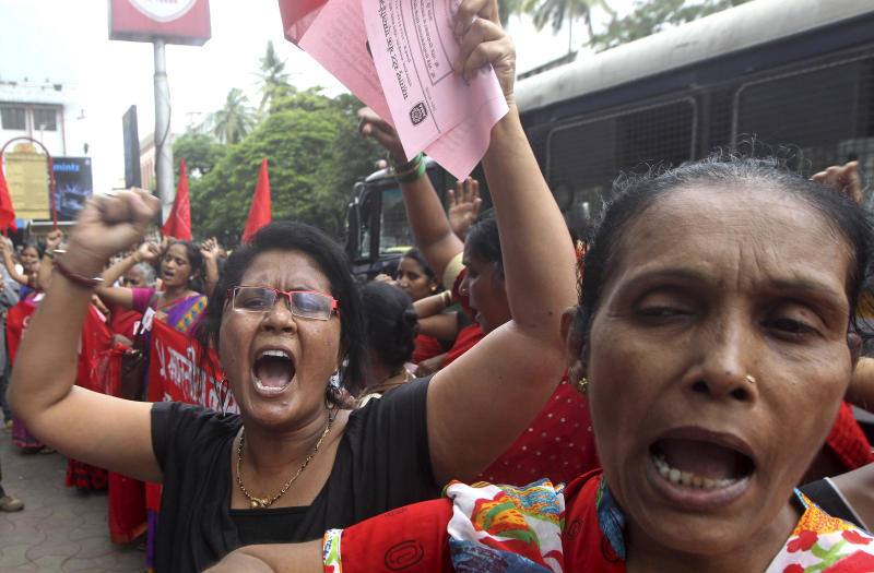 FILE - In this Aug. 21, 2013 file photo, Indian women shout slogans during a protest against the killing of social activist Narendra Dabholkar in Mumbai, India. Lawmakers have passed a bill aimed at debunking black magic and prosecuting religious charlatans in a western Indian state after the murder of rationalist activist Dabholkar who campaigned nearly two decades for the legislation. (AP Photo/Rajanish Kakade, File)
