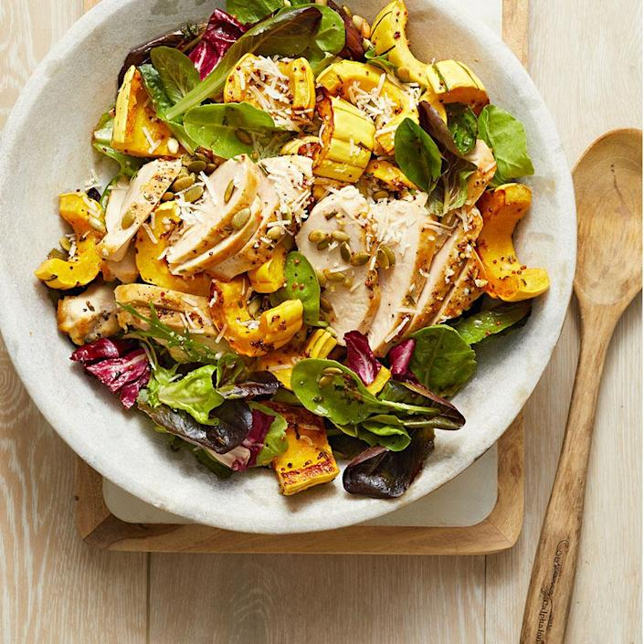 """<p>This hearty salad comes together with little effort, since the squash and chicken can roast together on the same sheet pan. Prep the dressing and the salad greens while the chicken is roasting. <a href=""""https://www.eatingwell.com/recipe/269122/roasted-chicken-winter-squash-over-mixed-greens/"""" rel=""""nofollow noopener"""" target=""""_blank"""" data-ylk=""""slk:View Recipe"""" class=""""link rapid-noclick-resp"""">View Recipe</a></p>"""