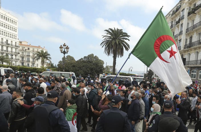 People demonstrate with Algerian flags for a second time this week in Algiers, Algeria, Feb. 26, 2021. Algerians turned out on Friday in the streets of the capital and scattered cities around their North African country to demonstrate in the pro-democracy movement, four days after tens of thousands of marchers marked Hirak's second anniversary. (AP Photo/Anis Belghoul)