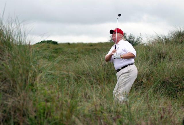 Donald Trump plays a round of golf at his Scotland golf course just after it opened in 2012.(Photo: Ian MacNicol/Getty Images)