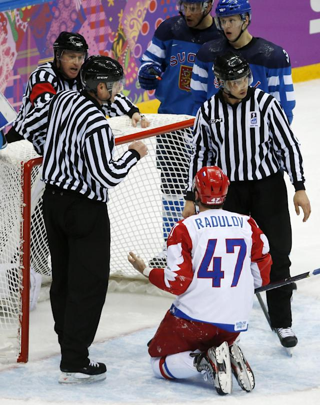 Russia forward Alexander Radulov appeals to officials after trying to score on Finland goaltender Tuukka Rask in the third period of a men's quarterfinal ice hockey game at the 2014 Winter Olympics, Wednesday, Feb. 19, 2014, in Sochi, Russia
