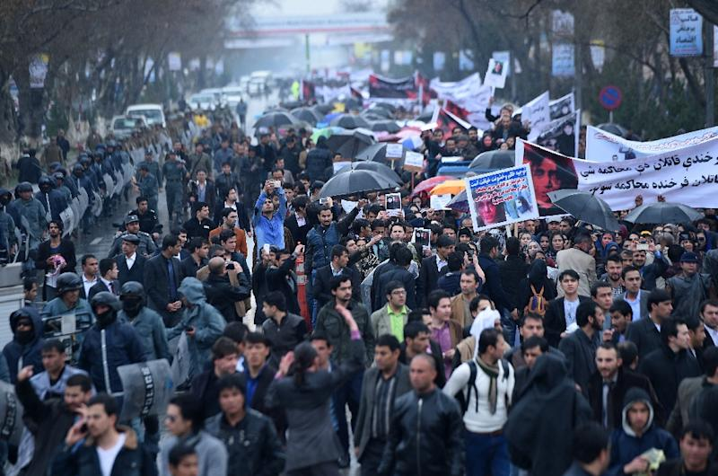 Afghan protesters hold banners as they shout slogans at a rally in front of the Supreme Court in Kabul on March 24, 2015, held to protest the killing of Afghan woman Farkhunda (AFP Photo/Wakil Kohsar)