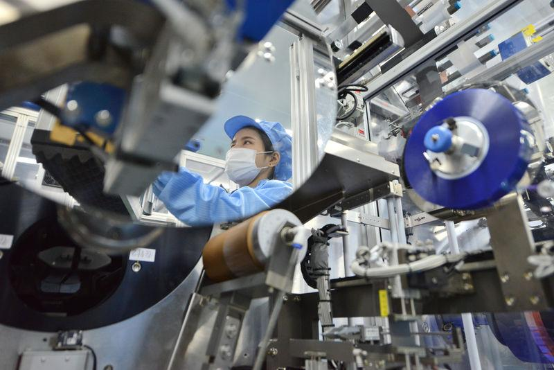 Worker is seen at the production line of lithium-ion batteries for electric vehicles (EV) at a factory in Huzhou