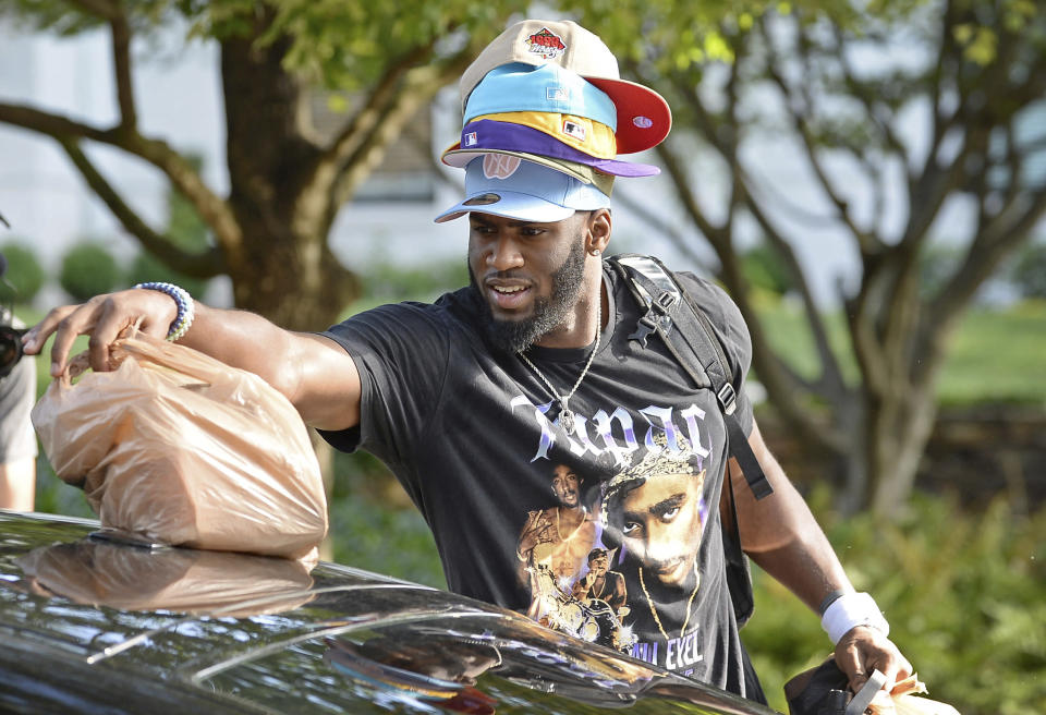 Carolina Panthers defensive end Brian Burns has a hat for all occasions as he unpacks his car at the team's dormitory at NFL football training camp, Tuesday, July 27, 2021, at Wofford College in Spartanburg, S.C. (Jeff Siner/The Charlotte Observer via AP)