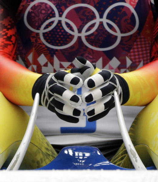 Tatjana Huefner of Germany prepares to start her first run during the women's singles luge competition at the 2014 Winter Olympics, Monday, Feb. 10, 2014, in Krasnaya Polyana, Russia. (AP Photo/Jae C. Hong)