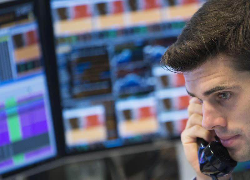 FILE PHOTO: Trader at the trading floor of KBC bank gives a phone call in Brussels