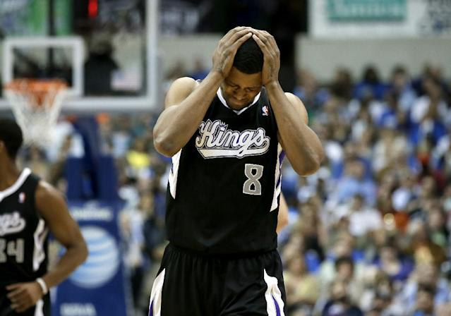 Sacramento Kings's Rudy Gay (8) reacts after a Kings turnover in the second half of an NBA basketball game against the Dallas Mavericks, Saturday, March 29, 2014, in Dallas. (AP Photo/Tony Gutierrez)