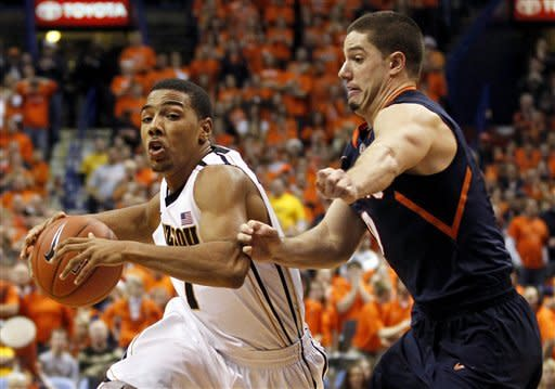 Missouri's Phil Pressey, left, heads to the basket past Illinois' Sam Maniscalco during the second half of an NCAA college basketball game, Thursday, Dec. 22, 2011, in St. Louis. Missouri won 78-74. (AP Photo/Jeff Roberson)