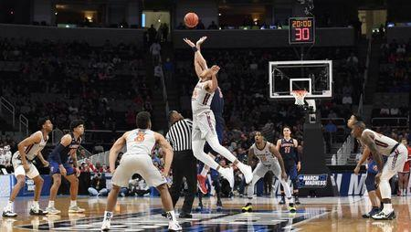 Mar 24, 2019; San Jose, CA, USA; Virginia Tech Hokies forward Kerry Blackshear Jr. (24) and Liberty Flames forward Scottie James (31) go up for the opening tip during the first half in the second round of the 2019 NCAA Tournament at SAP Center. Mandatory Credit: Kelley L Cox-USA TODAY Sports