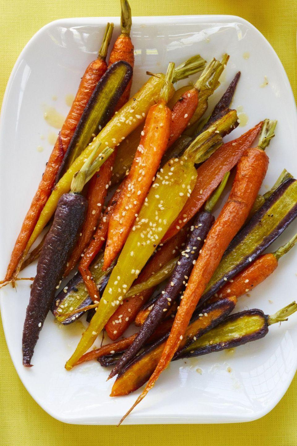 "<p>Not all glazed carrots need to be sweet — tart and tangy carrots can be just as delicious. </p><p><em><a href=""https://www.womansday.com/food-recipes/food-drinks/a19121978/roasted-carrots-with-citrus-vinaigrette-recipe/"" rel=""nofollow noopener"" target=""_blank"" data-ylk=""slk:Get the recipe from Woman's Day »"" class=""link rapid-noclick-resp"">Get the recipe from Woman's Day »</a></em></p>"