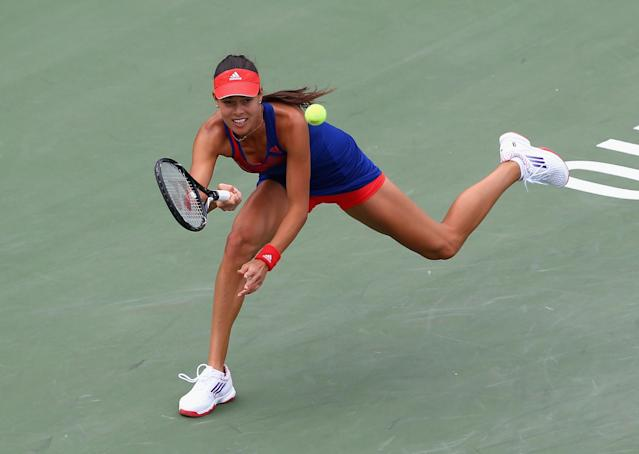 TORONTO, ON - AUGUST 06: : Ana Ivanovic of Serbia hits a return in her match against Su-Wei Hsieh during day 2 of the Rogers Cup Toronto at Rexall Centre at York University on August 6, 2013 in Toronto, Ontario,Canada. (Photo by Andy Lyons/Getty Images)