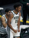 Michigan State guard A.J. Hoggard reacts after a teammate's basket during the second half of an NCAA college basketball game against Detroit Mercy, Friday, Dec. 4, 2020, in East Lansing, Mich. (AP Photo/Carlos Osorio)